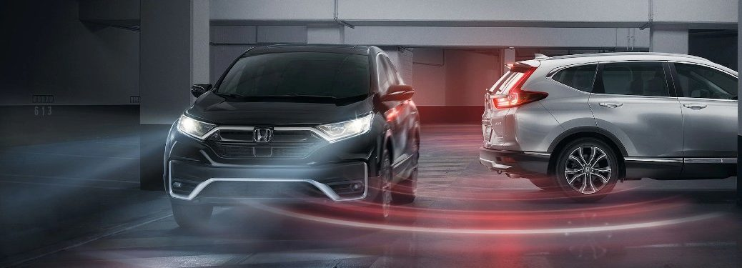 Graphic of a silver 2021 Honda CR-V using Cross Traffic Monitor with a black 2021 Honda CR-V driving behind it