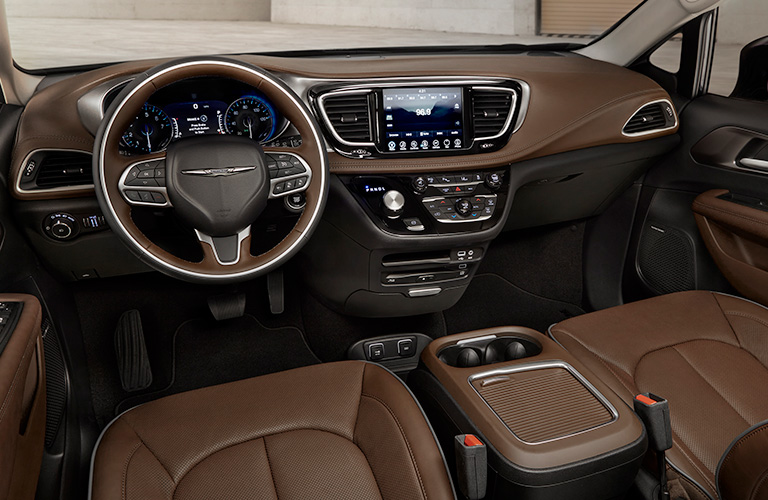 Front two seats and steering wheel inside 2019 Chrysler Pacifica