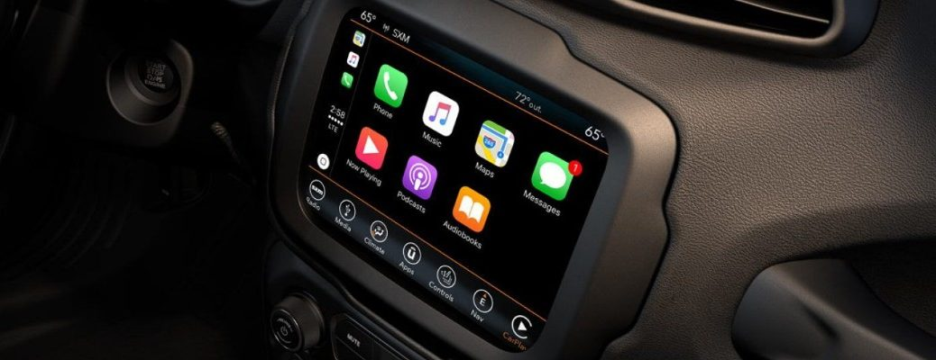 Center touchscreen of Uconnect infotainment screen showing Apple CarPlay interface