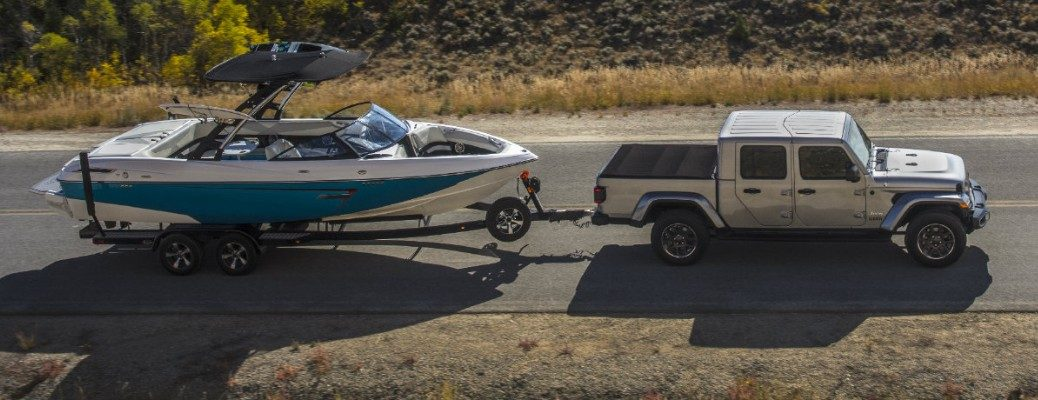 2020 Jeep Gladiator towing boat down highway