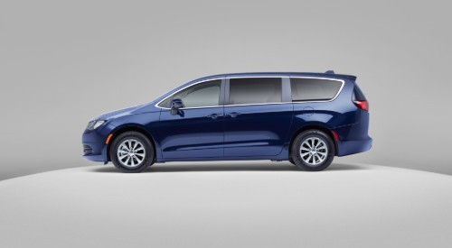 Profile view of blue 2020 Chrysler Voyager on silver background