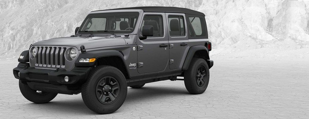 Gray 2019 Jeep Wrangler parked with trees in background