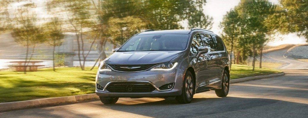 Front view of 2020 Chrysler Pacifica Hybrid driving on parkway