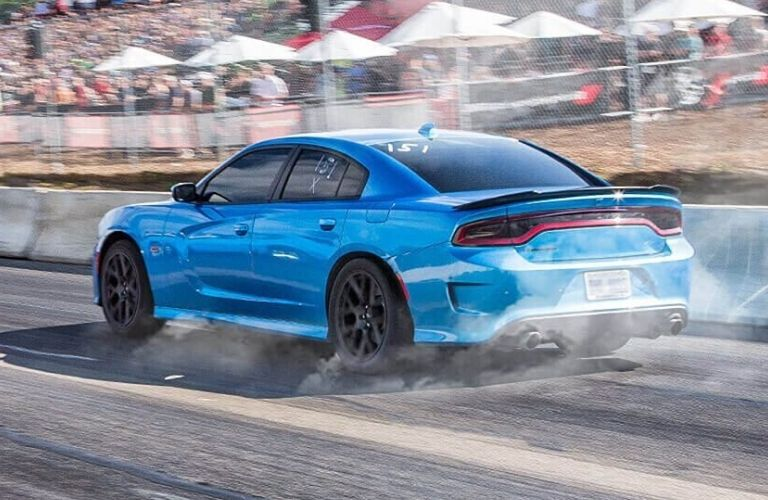 Exterior view of the rear of a blue 2019 Dodge Charger