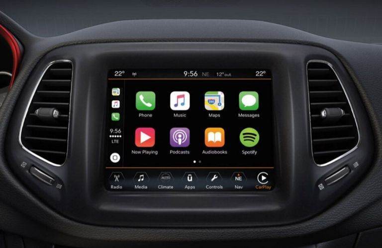 Closeup image of Apple CarPlay® on the Uconnect System touchscreen inside a Jeep