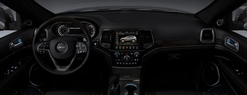 Interior view of a Jeep showing the Uconnect System touchscreen display