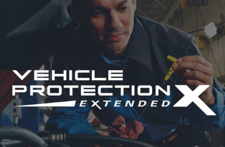 Mopar® Vehicle Protection Extended logo against the background of a service technician