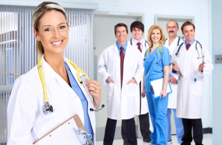 Image of a group of doctors and nurses smiling for the camera