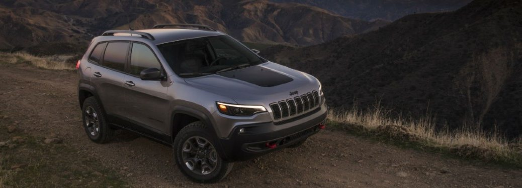 2021 Jeep Cherokee driving down a road