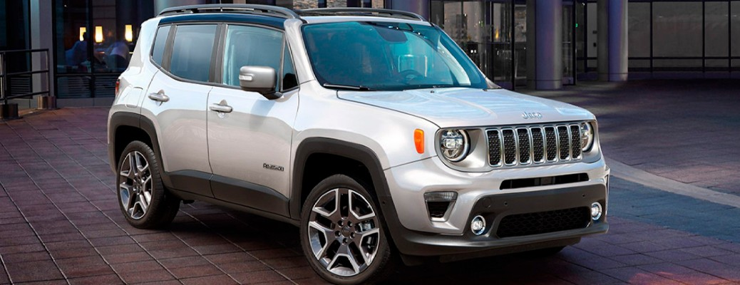 White colored 2021 Jeep Renegade driving down a road