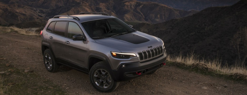 2021 Jeep Cherokee driving on a road at night
