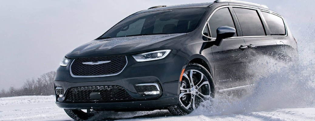 The 2021 Chrysler Pacifica driving through snow