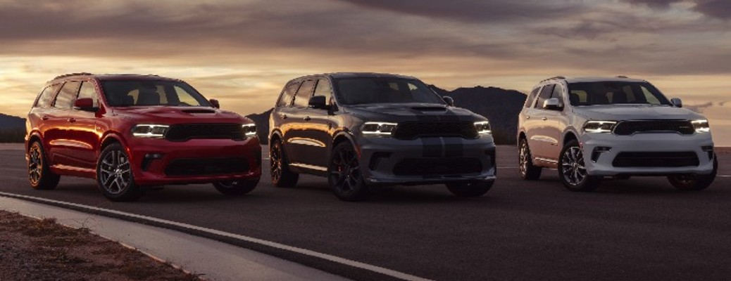 Three 2021 Dodge Durango vehicles parked outside in a row
