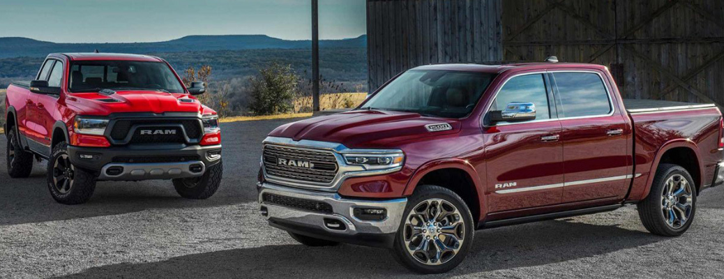 Two 2019 Ram 1500 models in front of hills