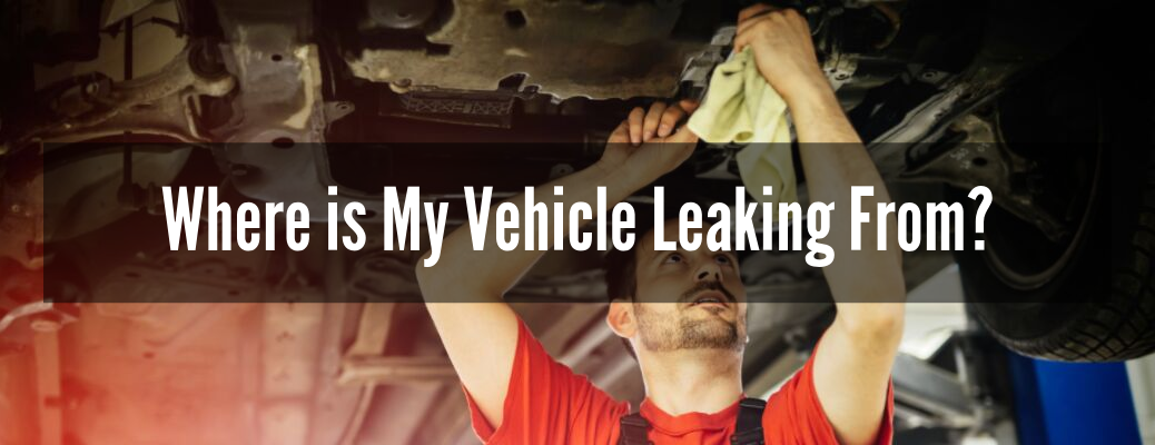 """Mechanic looking under vehicle with """"Where is My Vehicle Leaking From?"""" white text"""