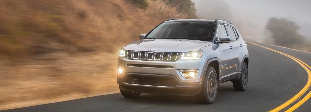 2020 Jeep Compass driving down a foggy road