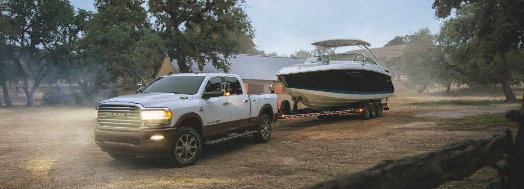 2020 Ram 2500 white exterior front fascia driver side towing a boat