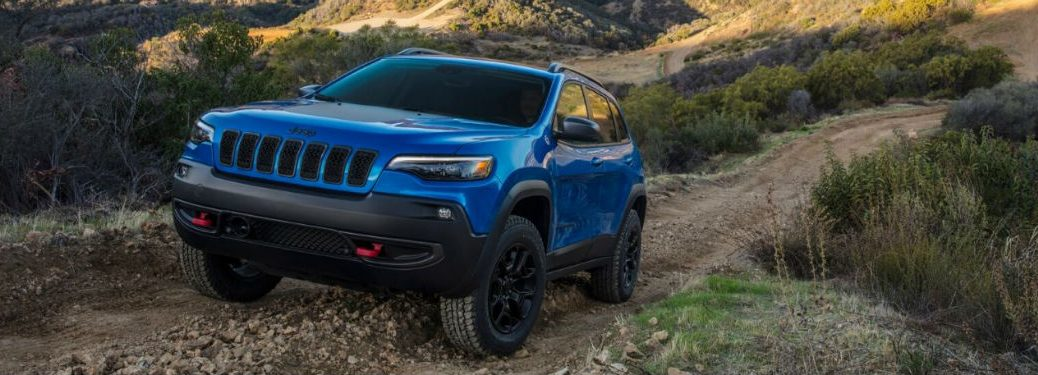 2020 Jeep Cherokee blue exterior front fascia driver side driving up off road hill