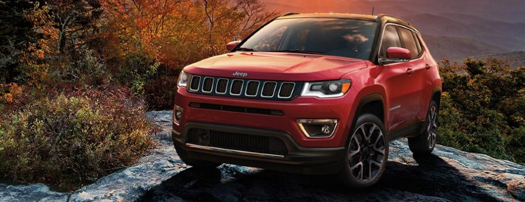 2020 Jeep Compass red exterior front driver side parked on cliff top