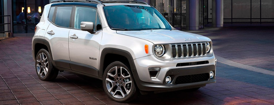 A 2021 Jeep Renegade driving on a road