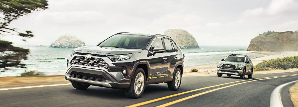 Two 2019 Toyota RAV4s driving down a highway