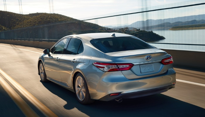 2019 Toyota Camry driving down a bridge