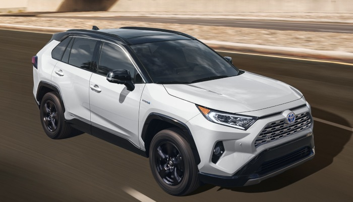 2019 Toyota RAV4 XLE driving down a highway