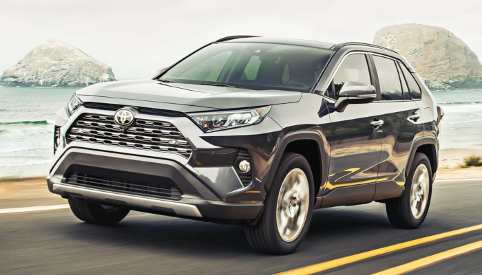2019 Toyota RAV4 driving down a road by the shore