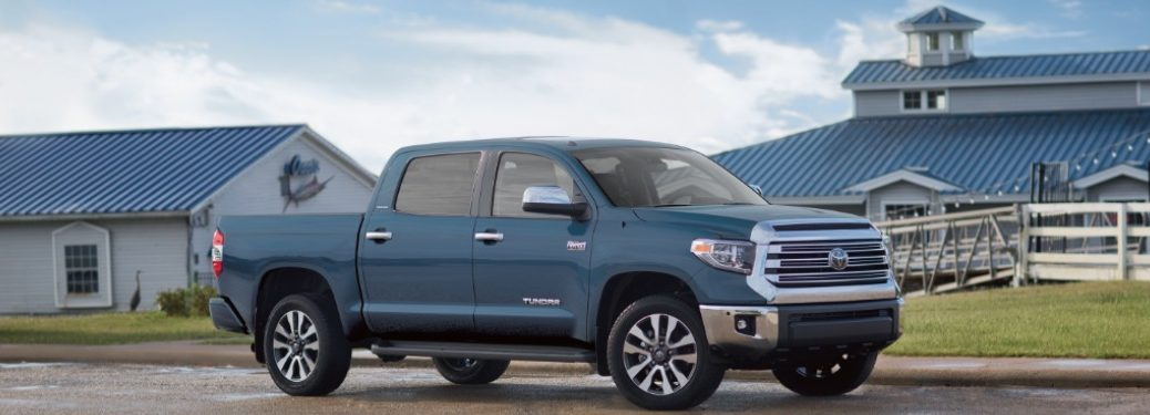 2019 Toyota Tundra parked in front of two buildings