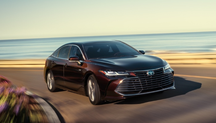 2019 Toyota Avalon Limited driving down a curved road