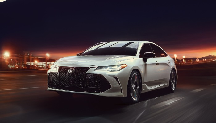 2019 Toyota Avalon Touring driving down a street at night