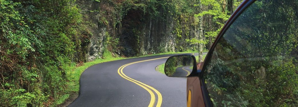 Car Driving on Winding Road