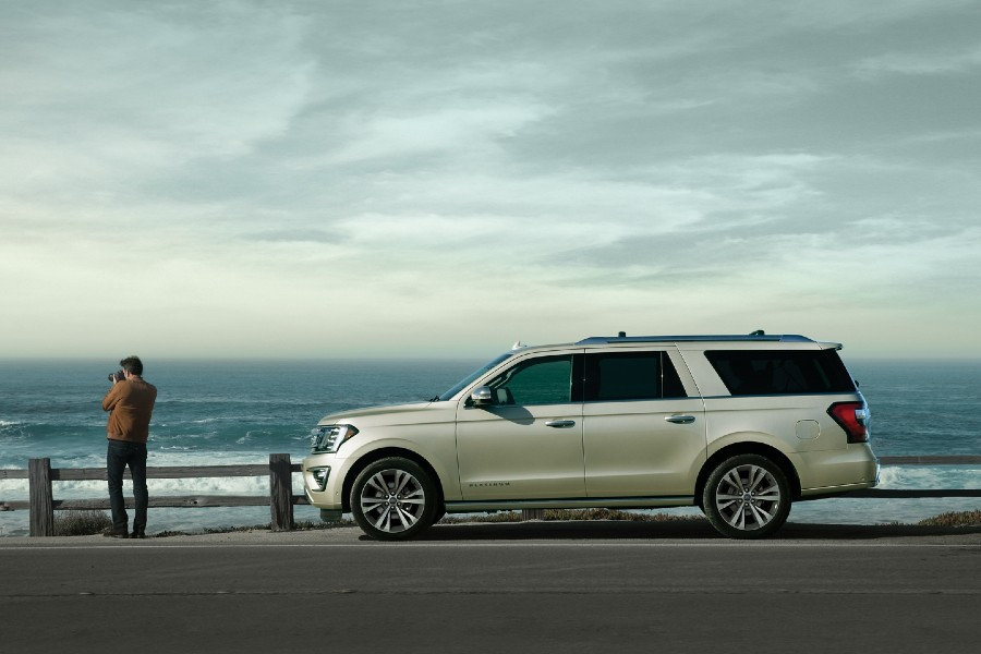 Driver angle of a white 2020 Ford Expedition parked by the ocean