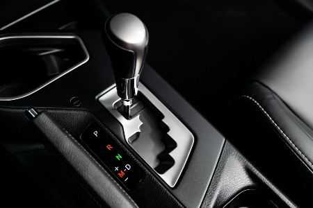 Close up of an automatic gear shift in a car