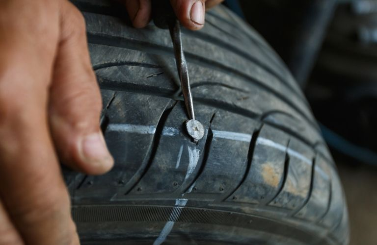 Removing the nail from a tire