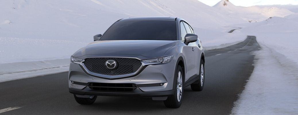2020 Mazda CX-5 driving on the road near snow