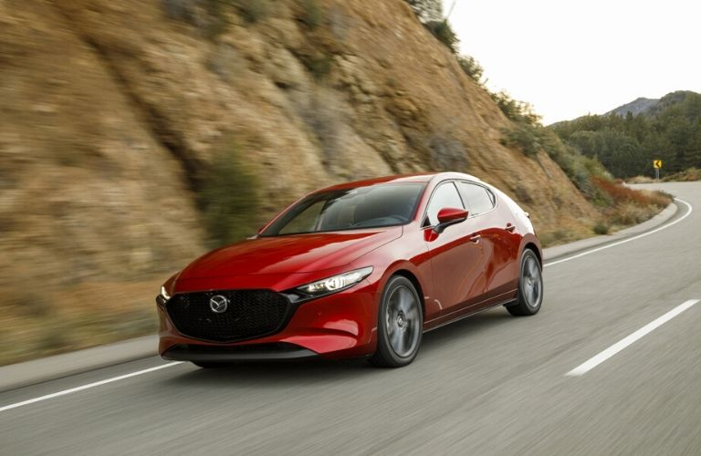 Red 2021 Mazda3 Driving on a road