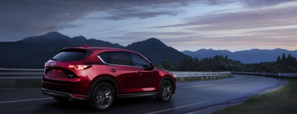 2021 Mazda CX-5 driving outside rear view