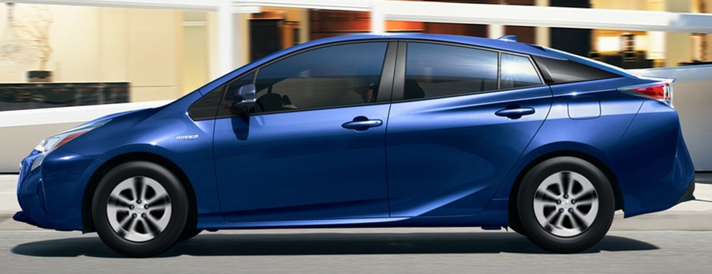 Side view of a 2018 Toyota Prius color blue