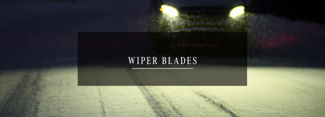 wiper blades text with headlights in background