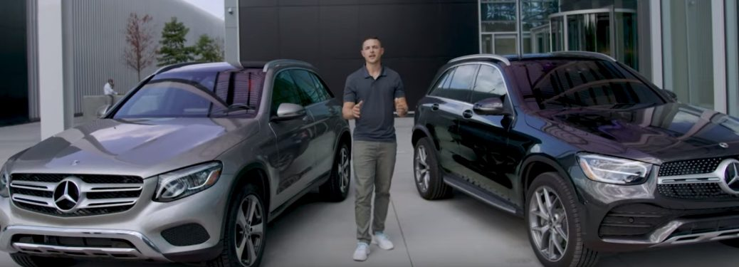 man standing between 2019 and 2020 mercedes-benz glc models