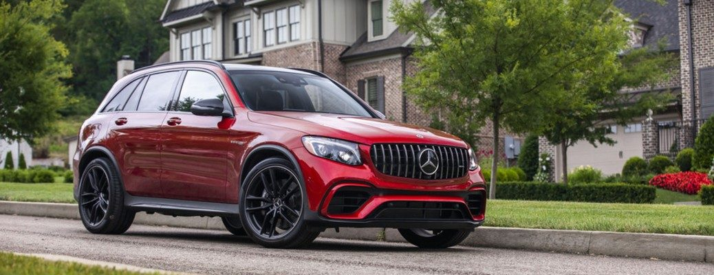 2018 Mercedes-AMG GLC SUV 63 4MATIC red paint parked on road in front of large houses
