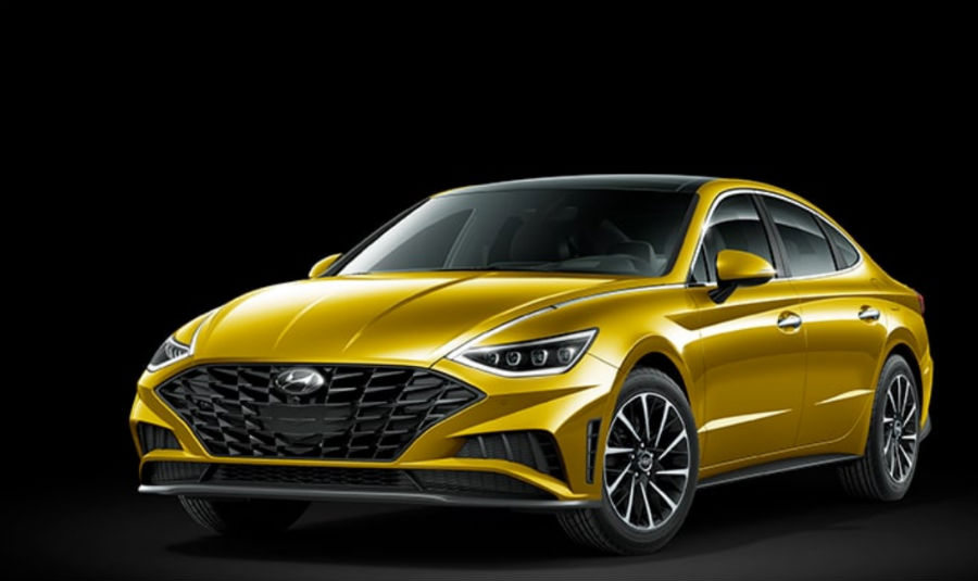 Glowing Yellow 2020 Hyundai Sonata exterior front fascia and driver side on black background