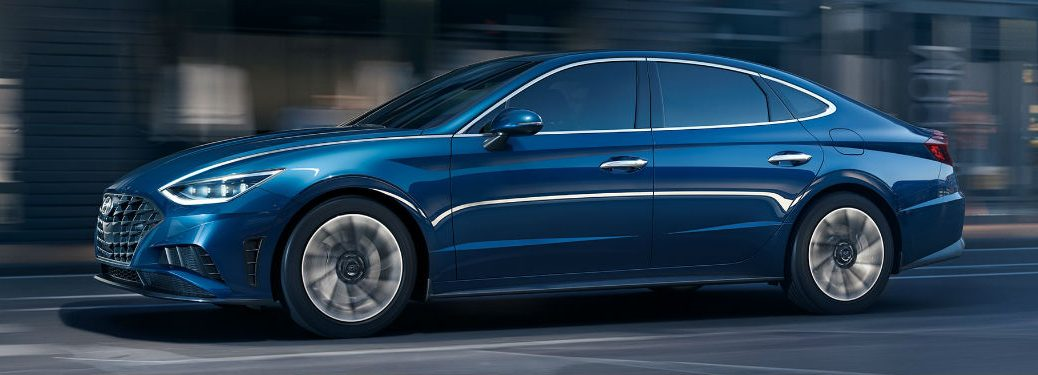 2020 Hyundai Sonata exterior front fascia and driver side going fast on dark city road