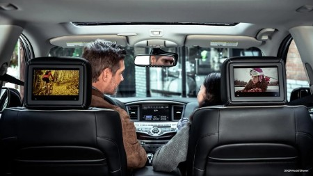 Entertainment screens on the back of the front row seats inside the 2019 INFINITI QX60 with the disclaimer *2019 model shown