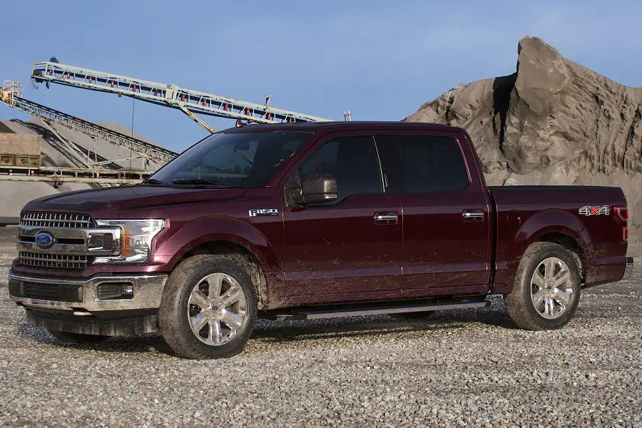 Front driver angle of the 2019 Ford F-150 in Magma Red color