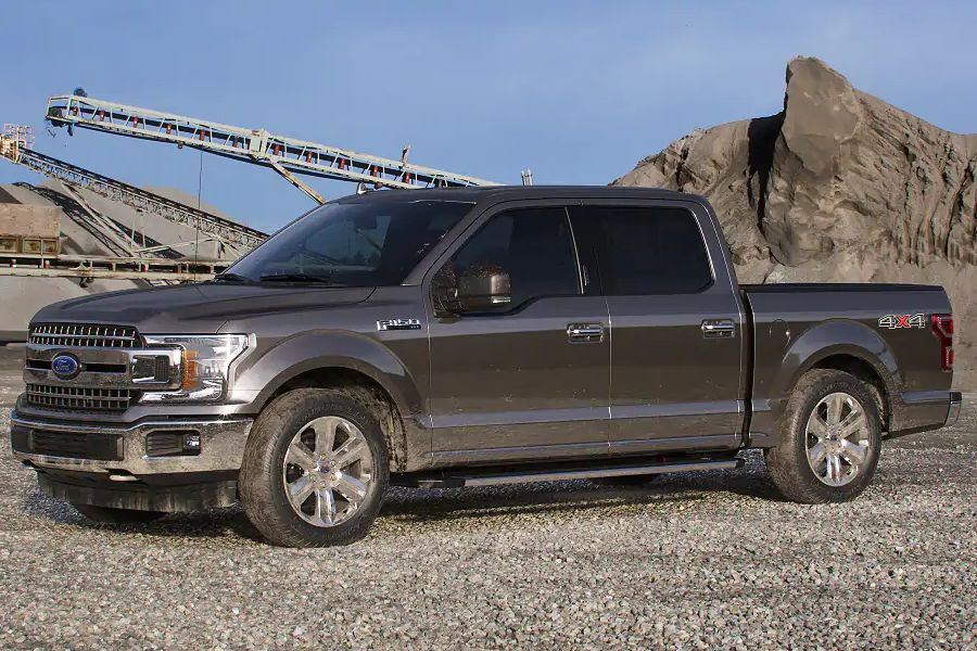 Front driver angle of the 2019 Ford F-150 in Stone Gray color