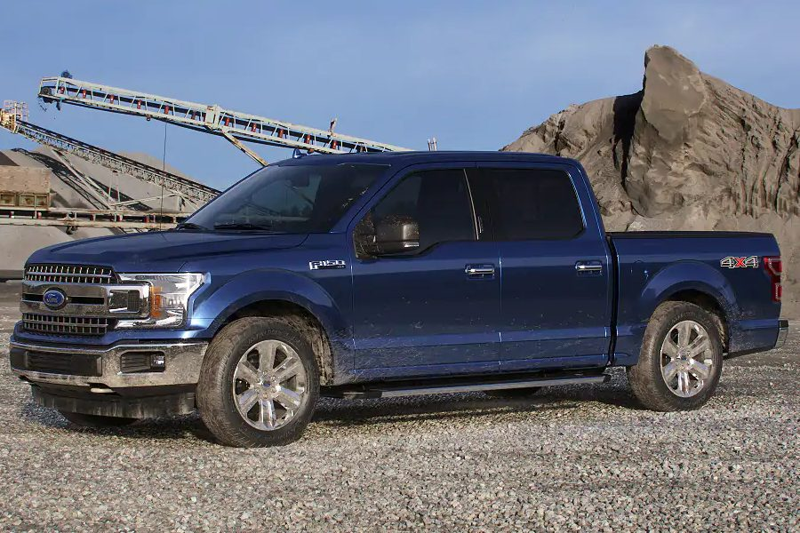 Front driver angle of the 2019 Ford F-150 in Blue Jeans color
