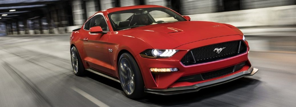 Front passenger angle of a red 2020 Ford Mustang