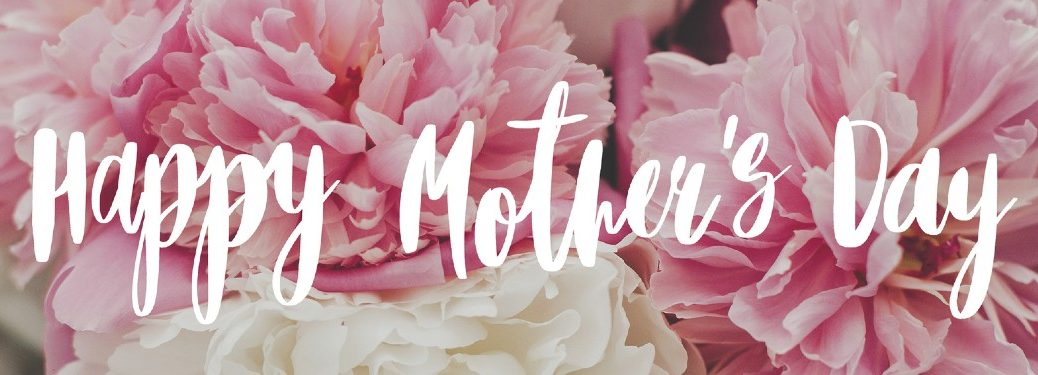 """The text """"Happy Mother's Day"""" with flowers in the background"""